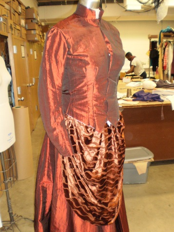 Jacket, skirt, and apron before fitting